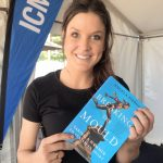 Anna Flanagan from the Hockeyroos holding a copy of Angela Pippos' book, Breaking the Mould.